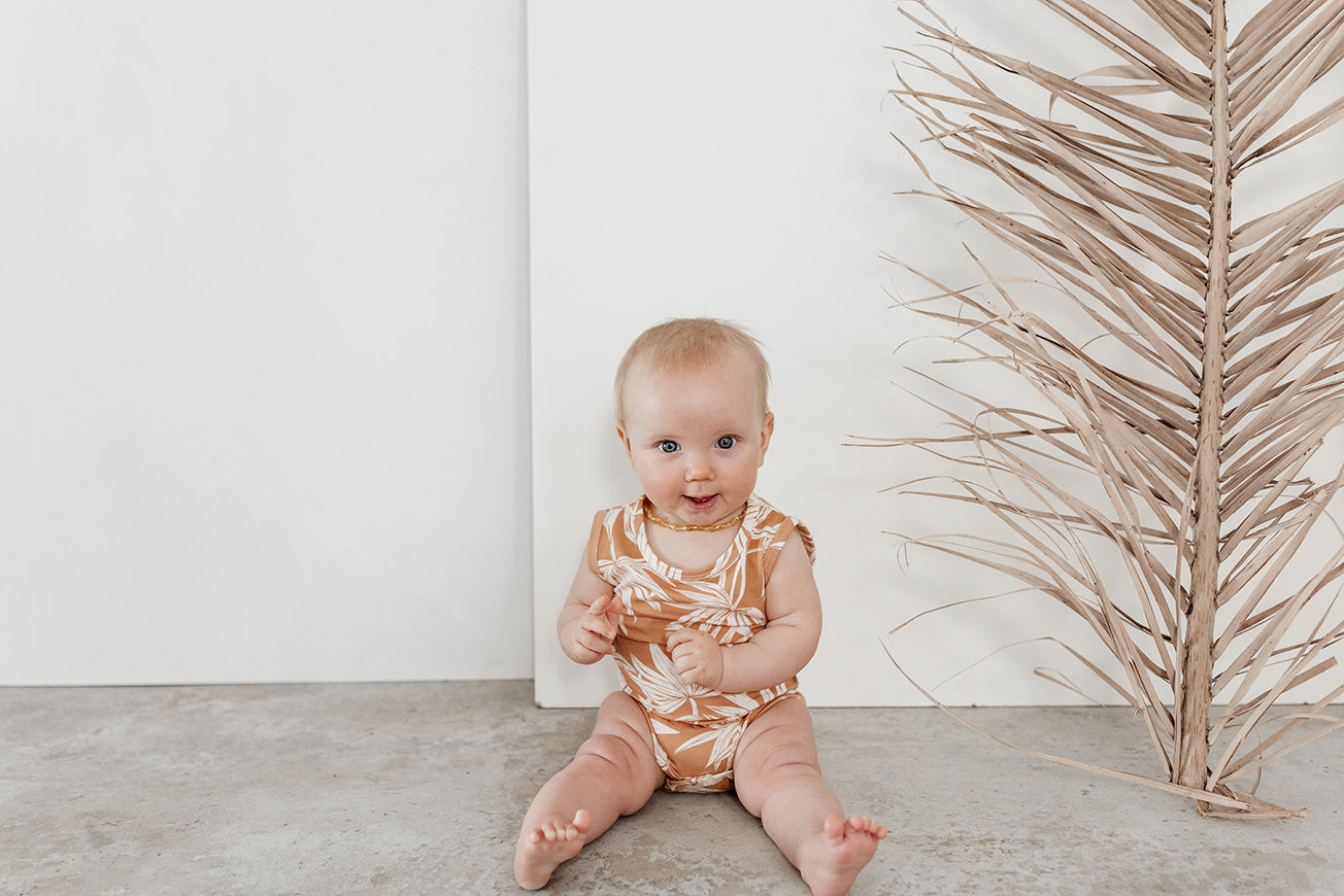baby wearing bamboo cotton onesie
