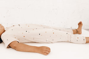 Short sleeve Jumpsuit with all over subtle Terrazzo print.