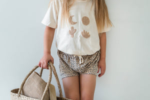 Cream coloured Tee with unique boucle embroidered design on front