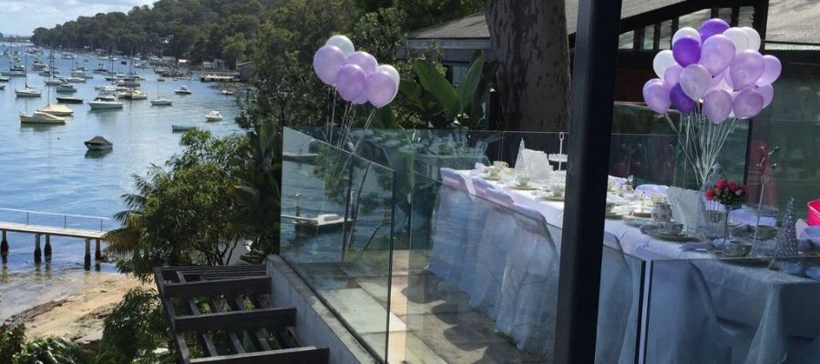 kids high tea party with balloons and party food