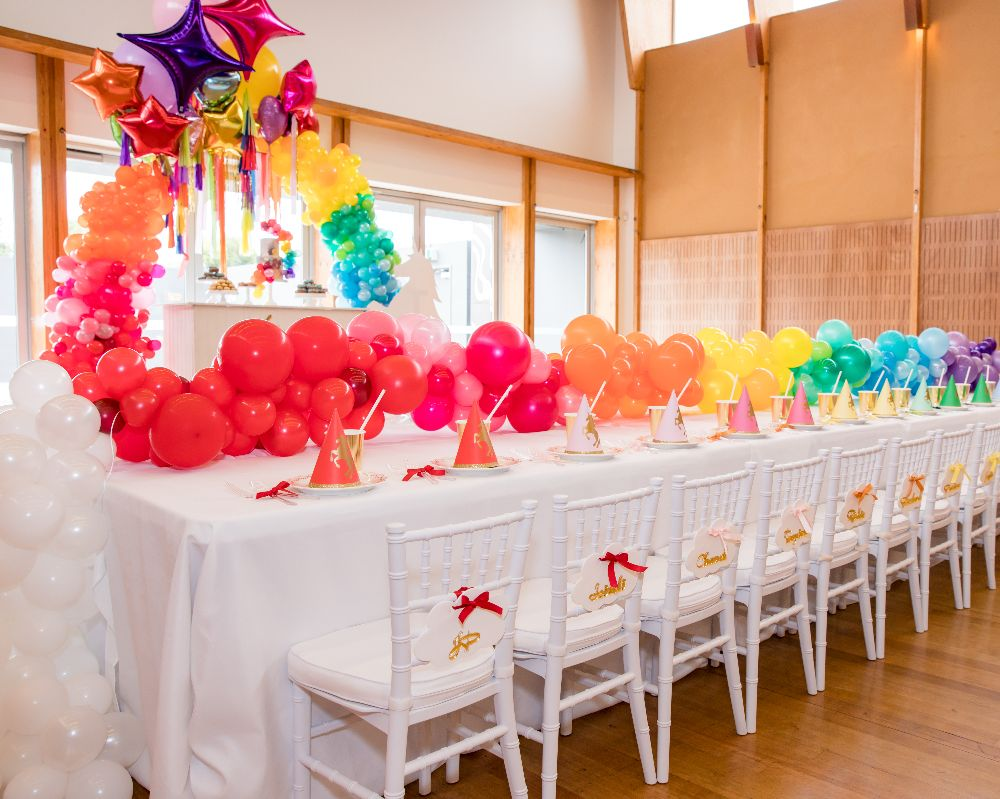 Unicorn Party styled kids table with balloon party decoration