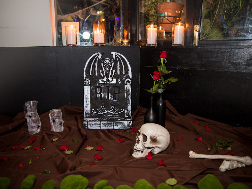 Halloween Decorations: DIY graveyard feature – gravestone, skeleton bones, spooky vase and moss