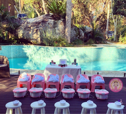 pink spa party set up in a backyard for a girls party