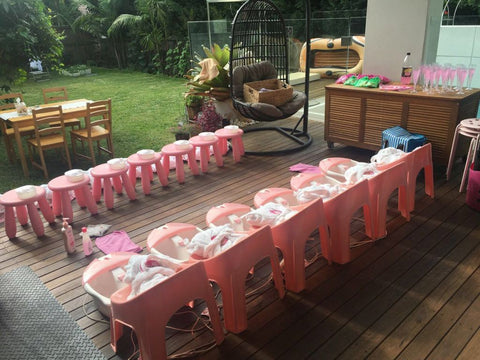 a party girl's pink and white pamper party set up