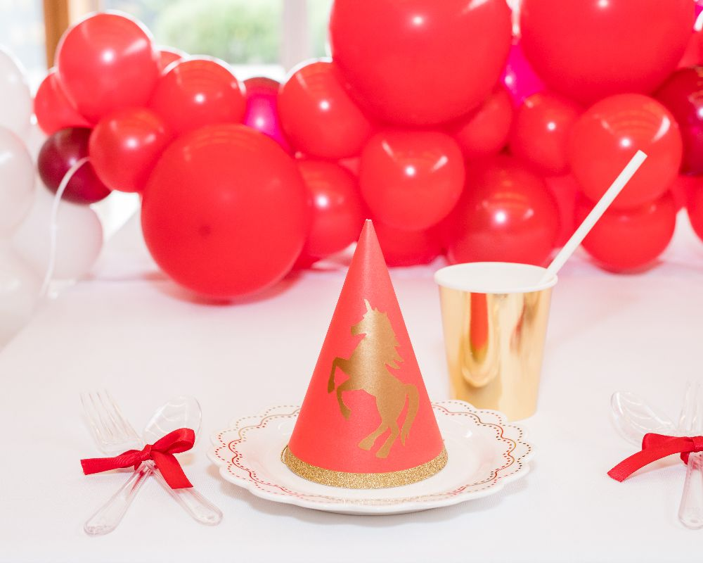 Kids Unicorn Party décor and party hat.<p style=