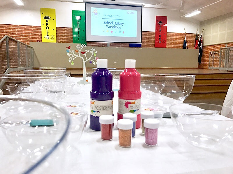 Slime making workshop: set up with paint and glitter slime ingredients