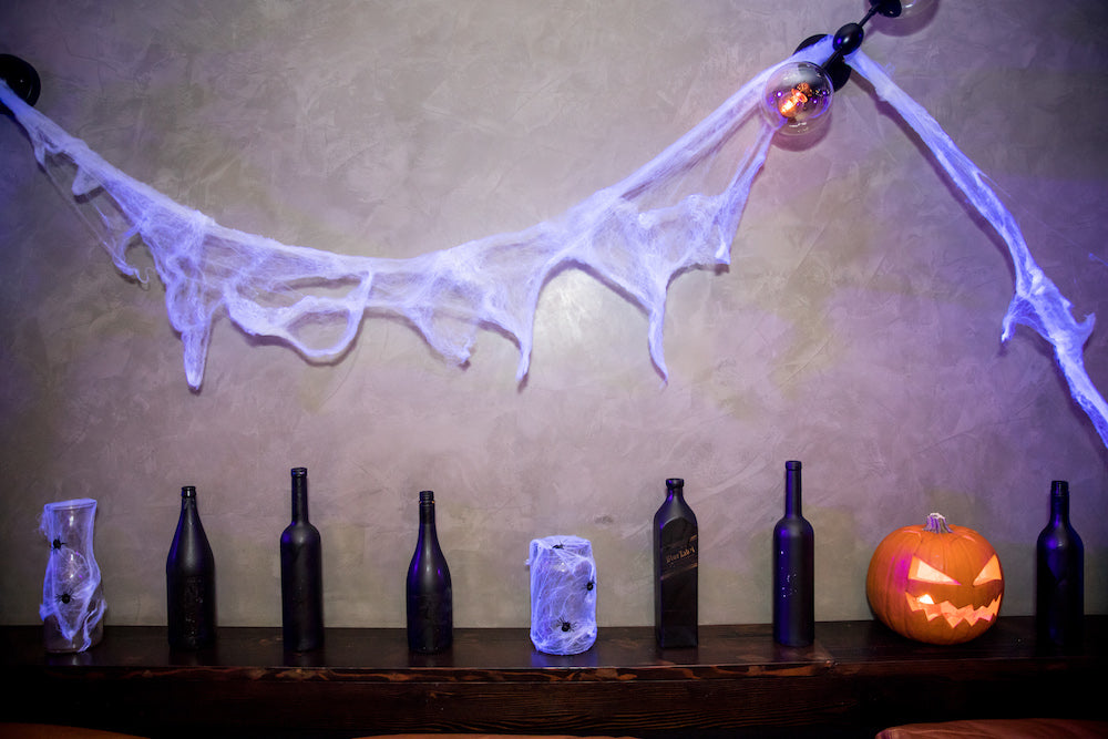 Halloween Decorations: Paint sprayed bottles with jack-o'-lantern and spider web jars and wall feature