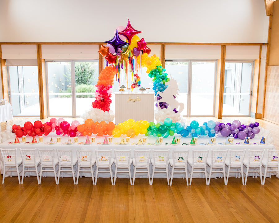Unicorn Kids Party Set Up; Kids table with Unicorn Cake and Unicorn Prop feature