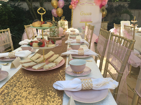 Pink and Gold Kids High Tea Party set up with Tiffany Chair Hire