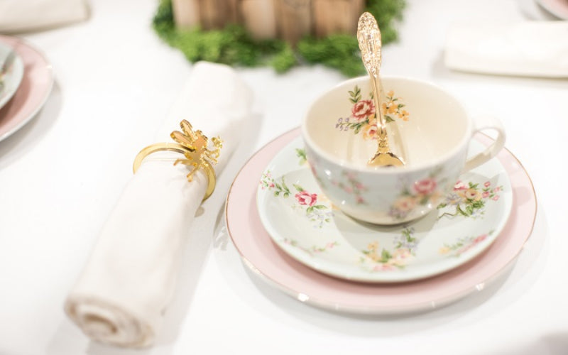Fairy Party close up of floral crockery with Fairy napkin ring