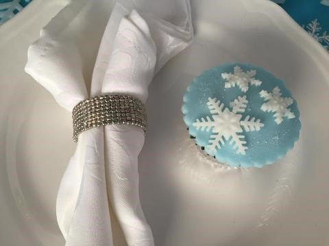 frozen theme party set up with a cupcake and themed kids high tea display