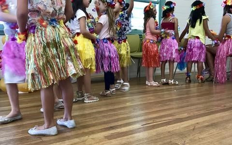 moana themed kids party with children dressed up and dancing