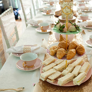 Kids High tea food on tiered stands with pink and gold crockery