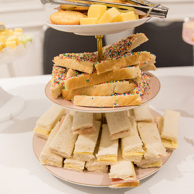 Kids high tea food on a tiered stand for a high tea party