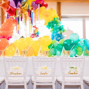 kids tiffany chair hire being used in a unicorn theme party set up