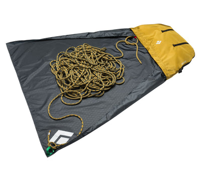 Black Diamond Super Chute climbing rope bag, open with rope laid on it