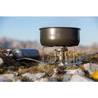 SOTO Storm Breaker Stove shown in use in the outdoors with pan