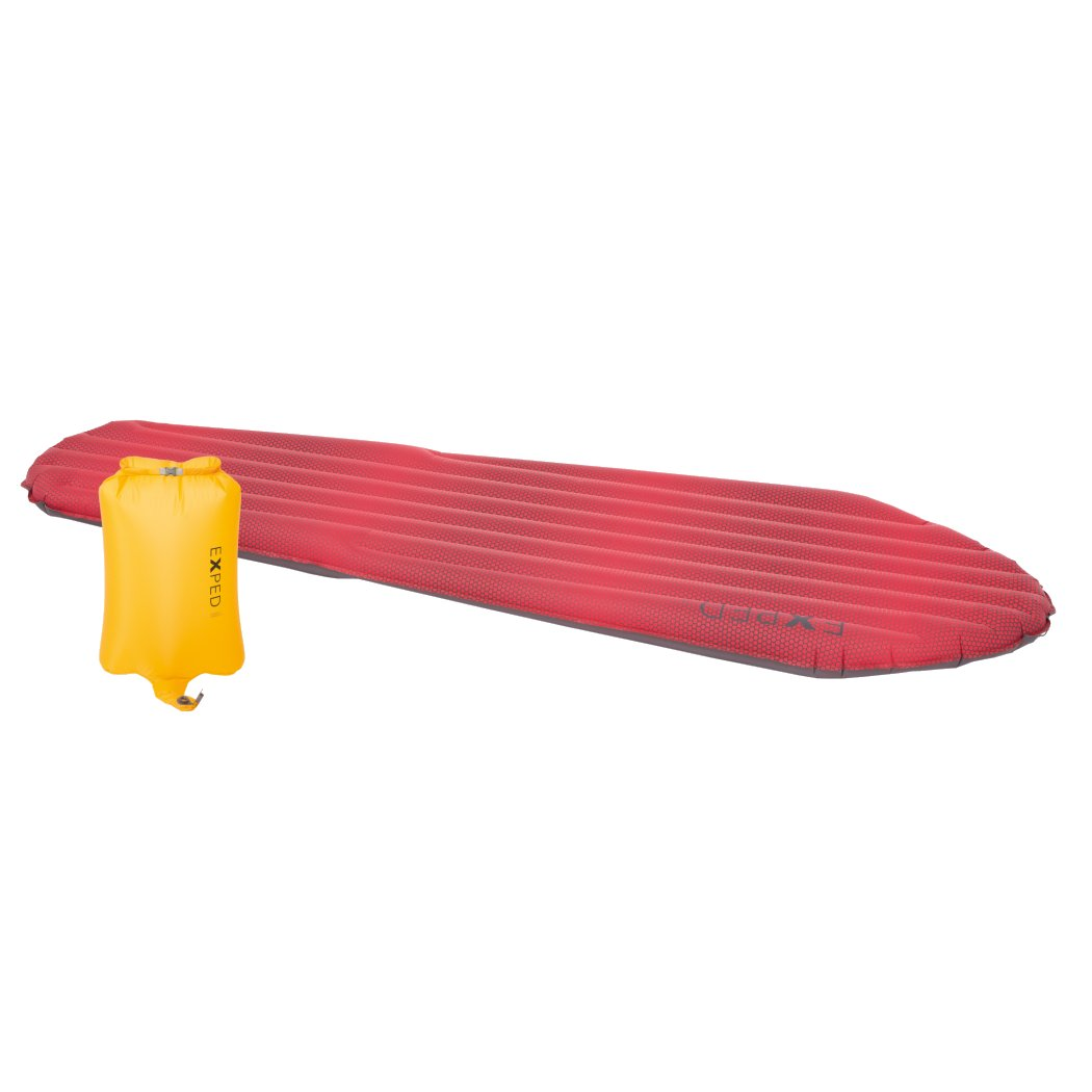 Exped SynMat HL Winter LW sleeping mat, shown laid out in red colour with yellow pump sack