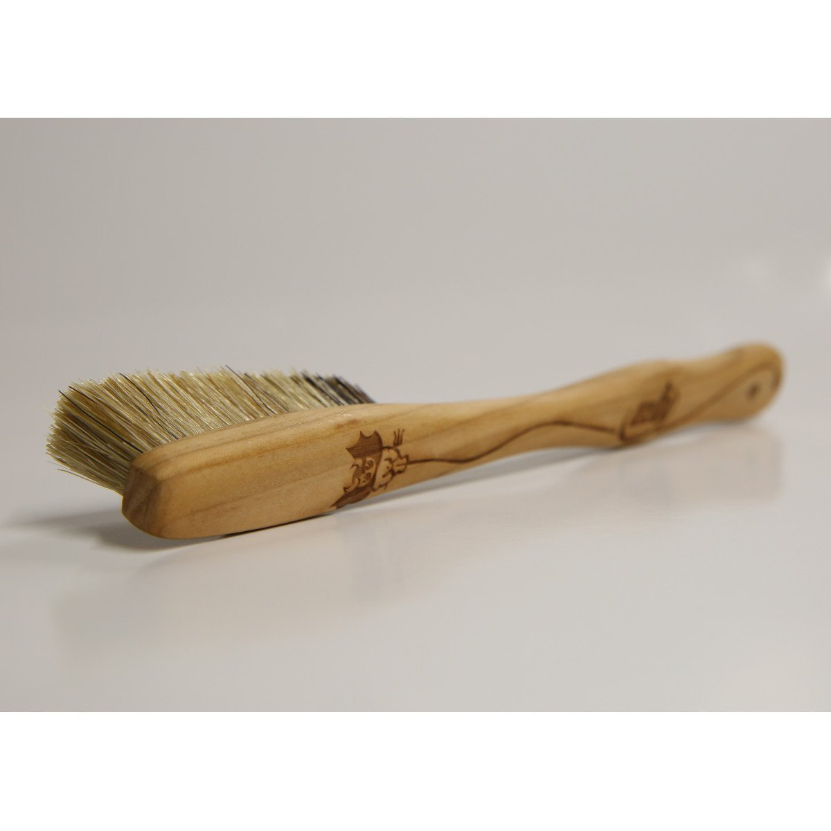 EB Cherry Wood Brush, shown laid on its side bristles facing away
