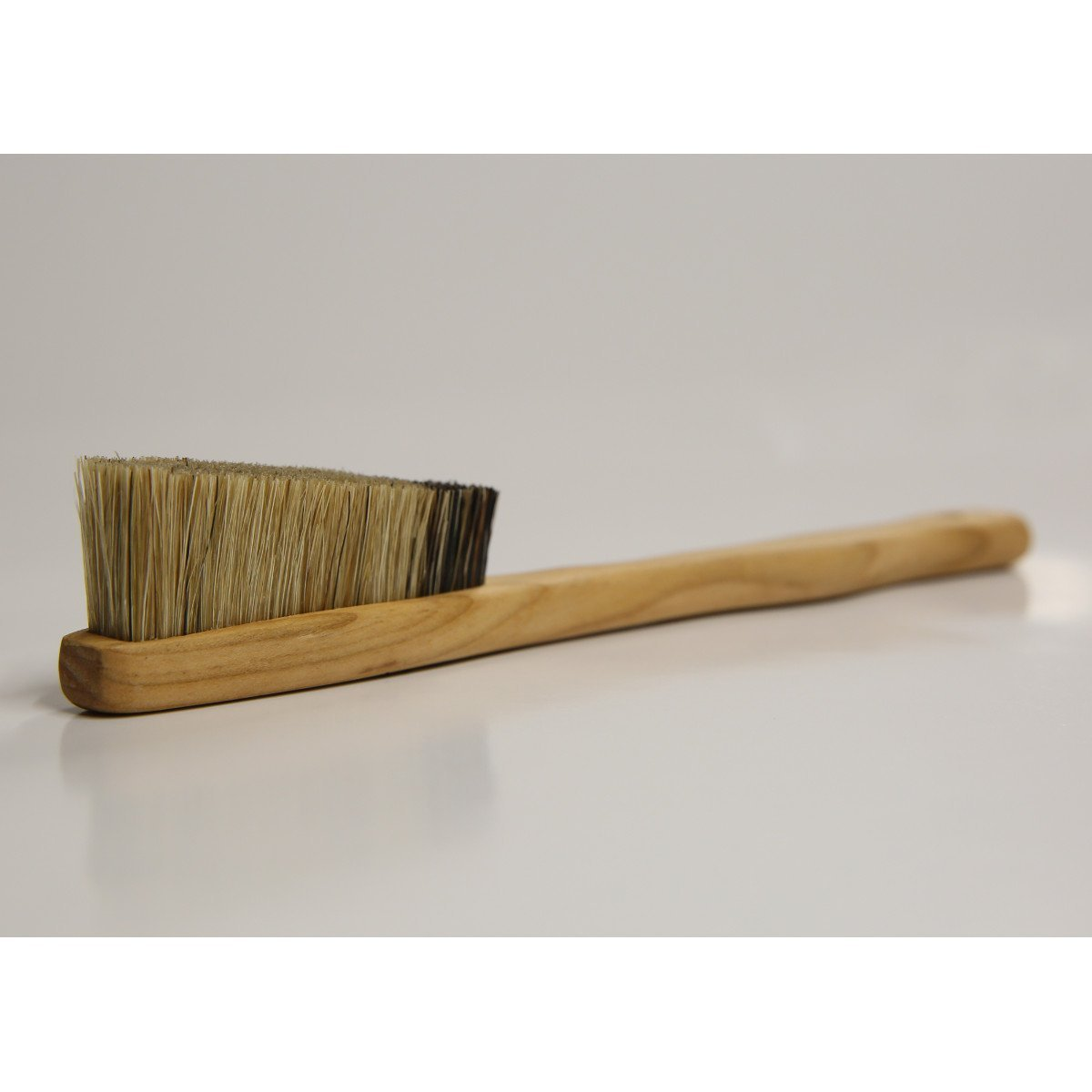 EB Cherry Wood Brush shown laid on a surface