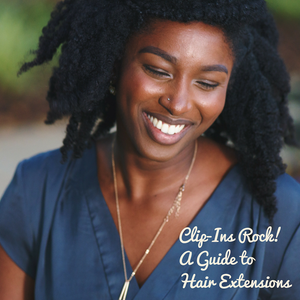 Clip-in extensions can enhance hairstyles such as this afro hairstyle worn by this happy woman