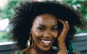 Happy Woman Wearing Afro Kinky Lace Front Wig