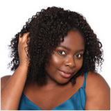 """Woman with 14"""" kinky curly Brazilian hair extensions"""