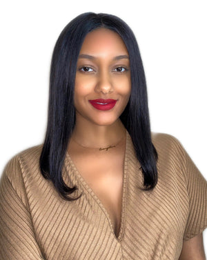 Woman demonstrates how a wearing a lob wig can create appearance of elongated features