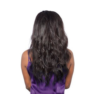 Teased out loose waves of the body wave hairstyle as seen from the back