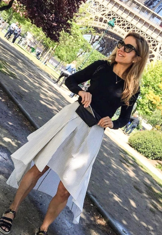 Melissa Posh, founder of Hi Love, wearing our black fanny pack in Paris.