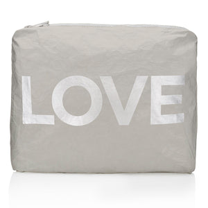 Medium gray travel pack with metallic silver love emblem
