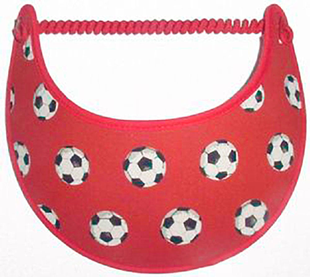 Foam sun visor with soccer balls on red background.