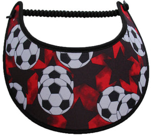 Foam sun visor with large soccer balls on red.