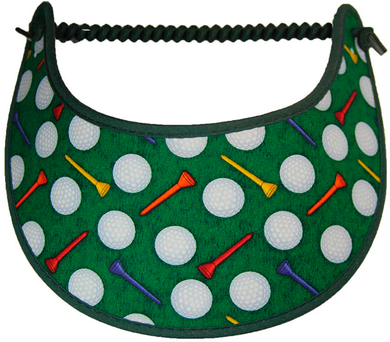 Foam sun visor with golf tees and balls on green