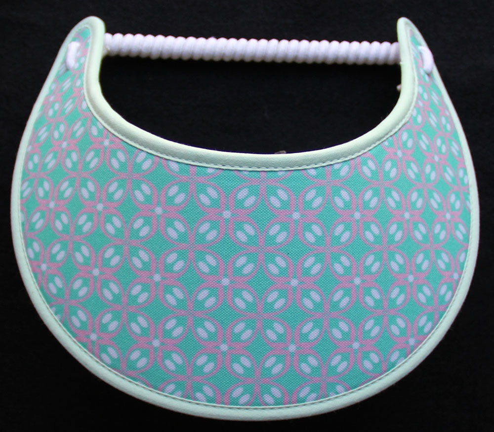 Foam sun visor with pink and white design on aquamarine