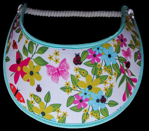 Ladies foam sun visor with flowers, butterflies, and lady bugs on white