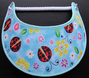 O230 LADY BUGS AND FLOWERS ON AQUA...EDGES TRIMMED IN AQUA