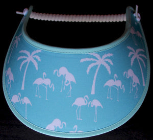 Foam sun visor with palm trees and flamingos on aqua.