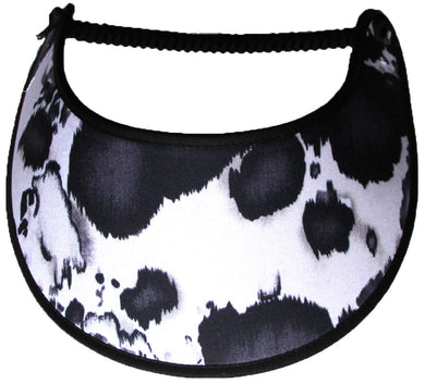 Foam sun visor with black and white cow print.