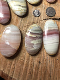 Pink banded calcite palm stone - Angel Eyes Shop