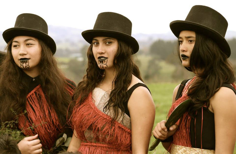 Stunning photo of three Maori girls in moody image
