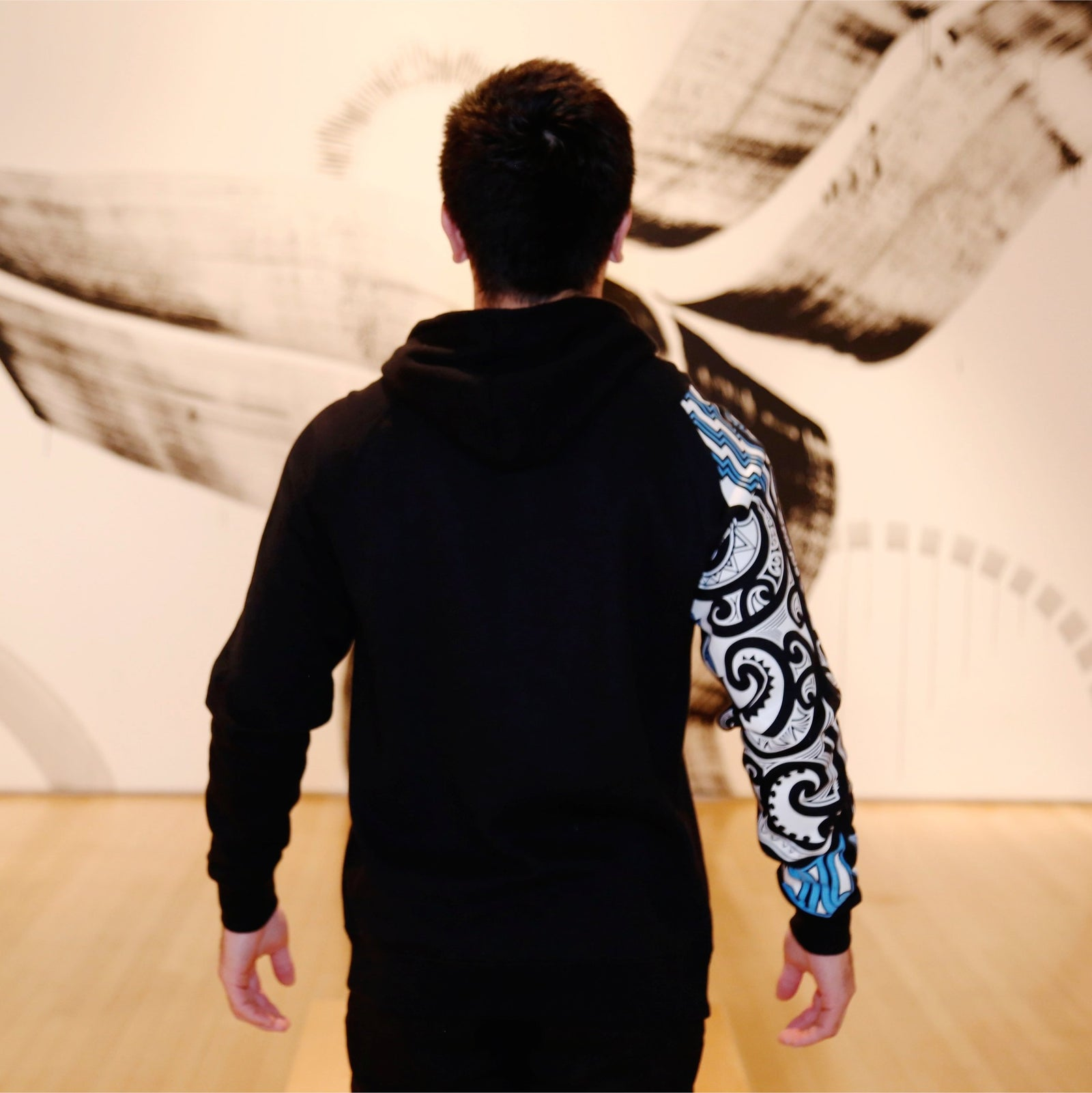 2 tone case hoodie with blue and white ta moko designed sleeve