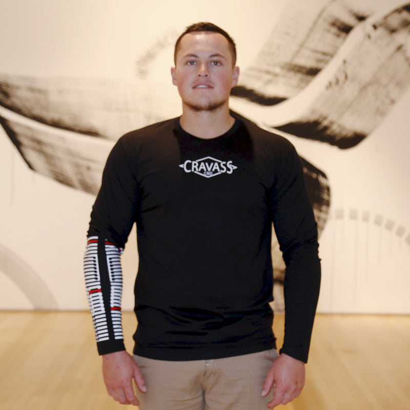 Mens black long sleeve tshirt with white and red ta moko designed forearm.