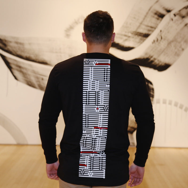 Mens black long sleeve tshirt with white and red ta moko designed back.