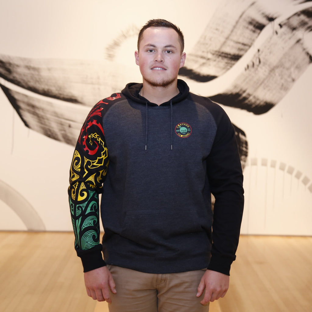unisex hoodie with red, green and red ta moko designed sleeve