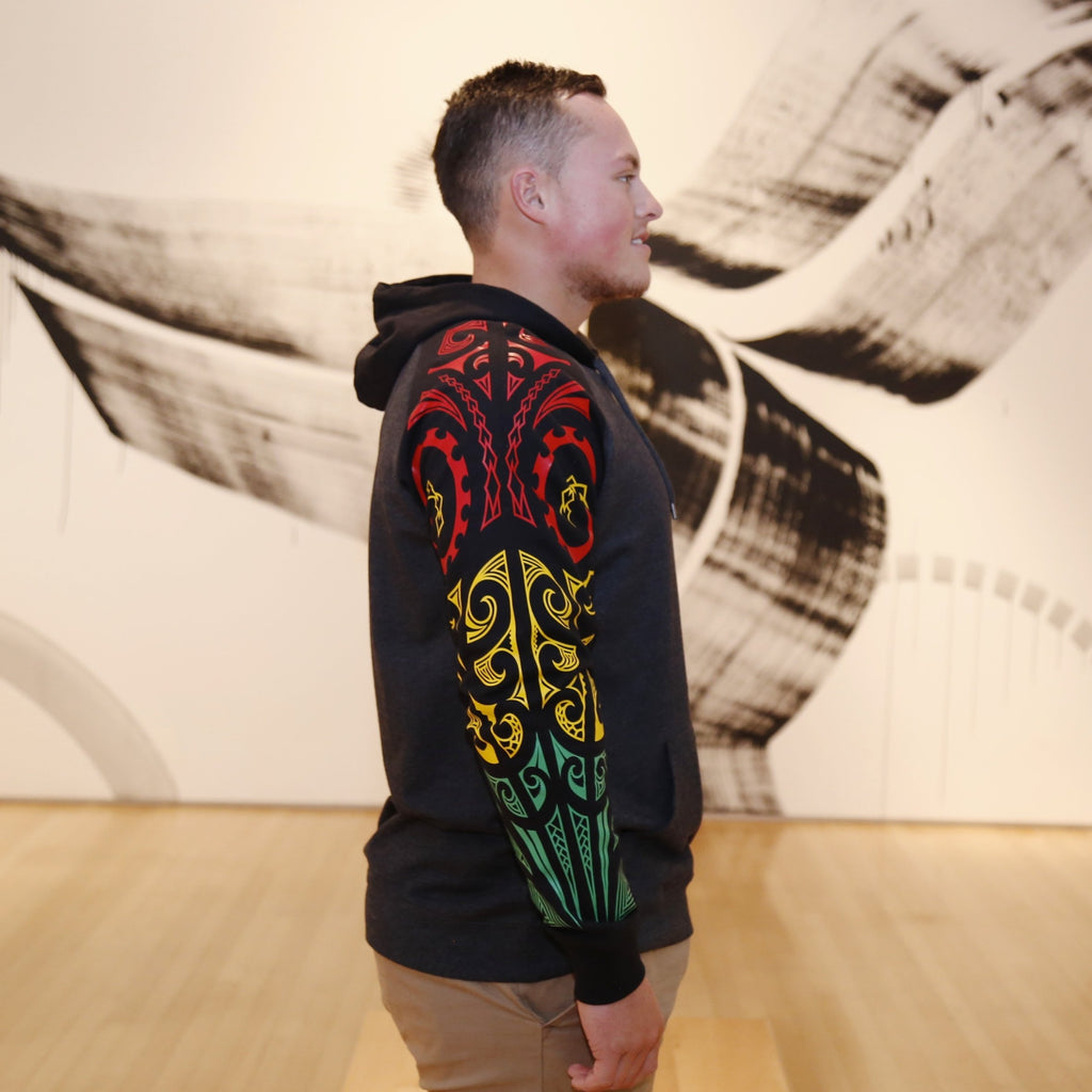 2 tone case hoodie with red, green and red ta moko designed sleeve