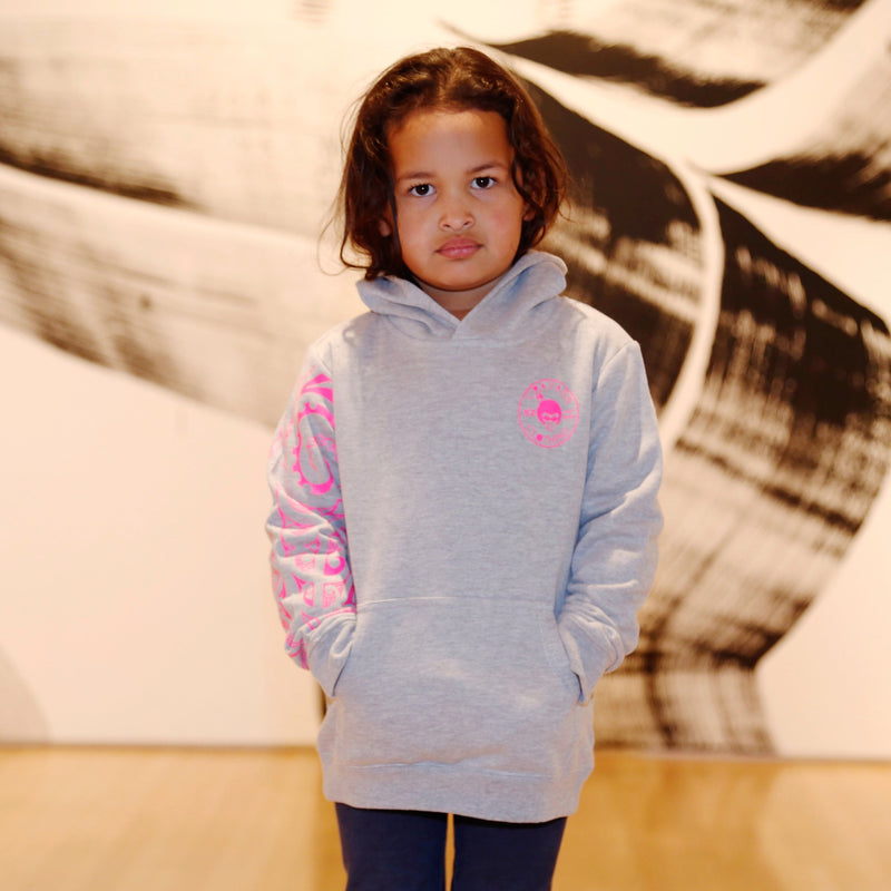 Fluro pink maori design on Kids Grey hoodie.