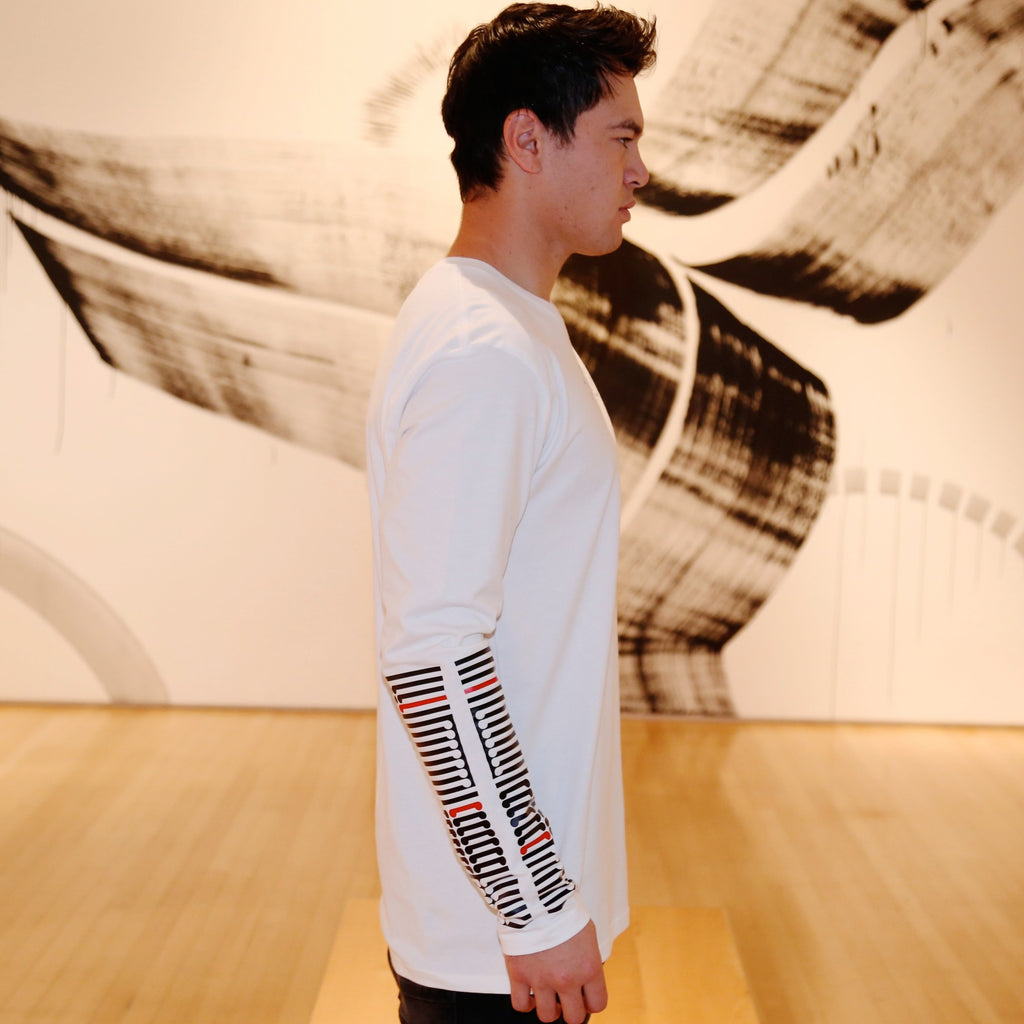 Mens white long sleeve tshirt with black and red ta moko designed forearm.
