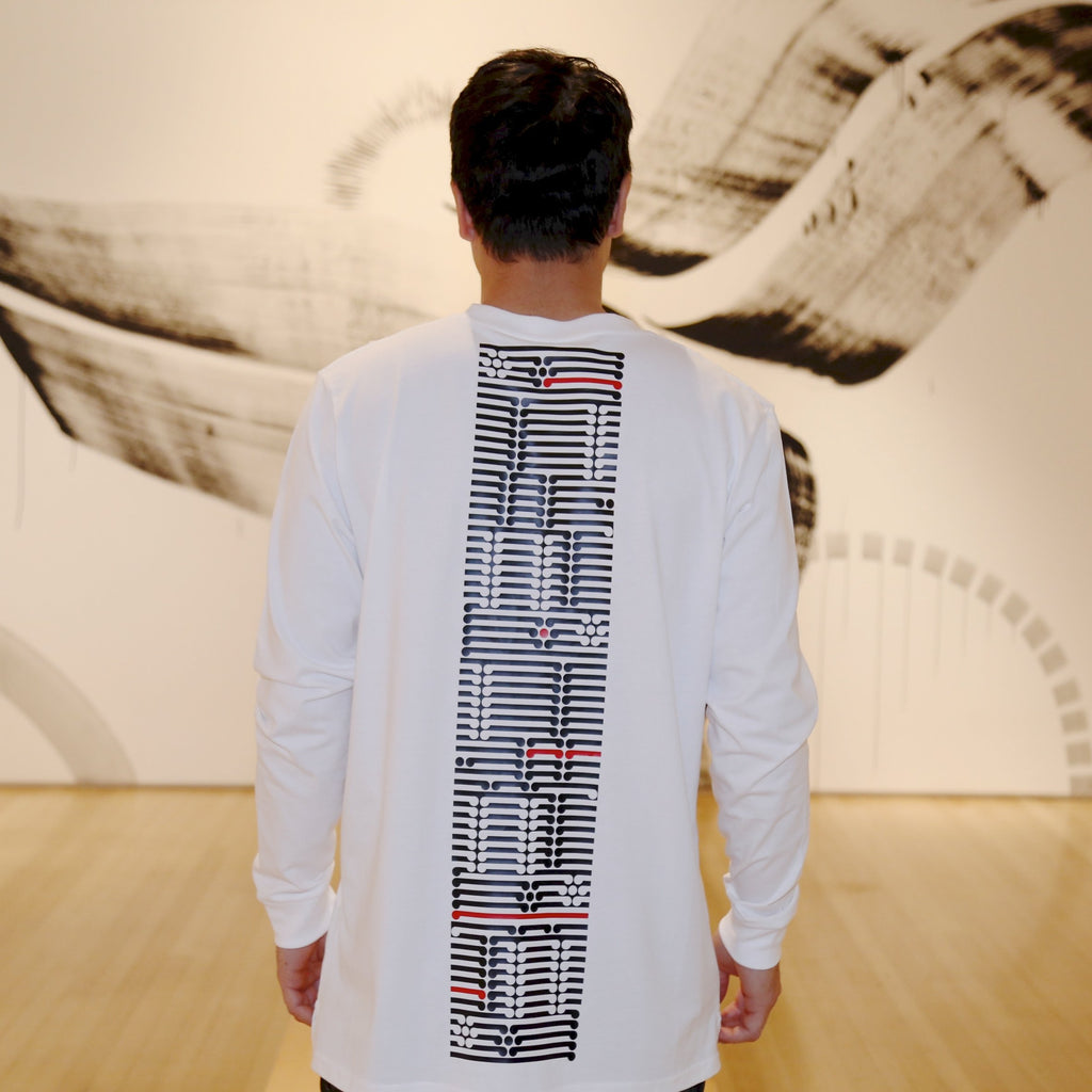 Mens white long sleeve tshirt with black and red ta moko design down the back.