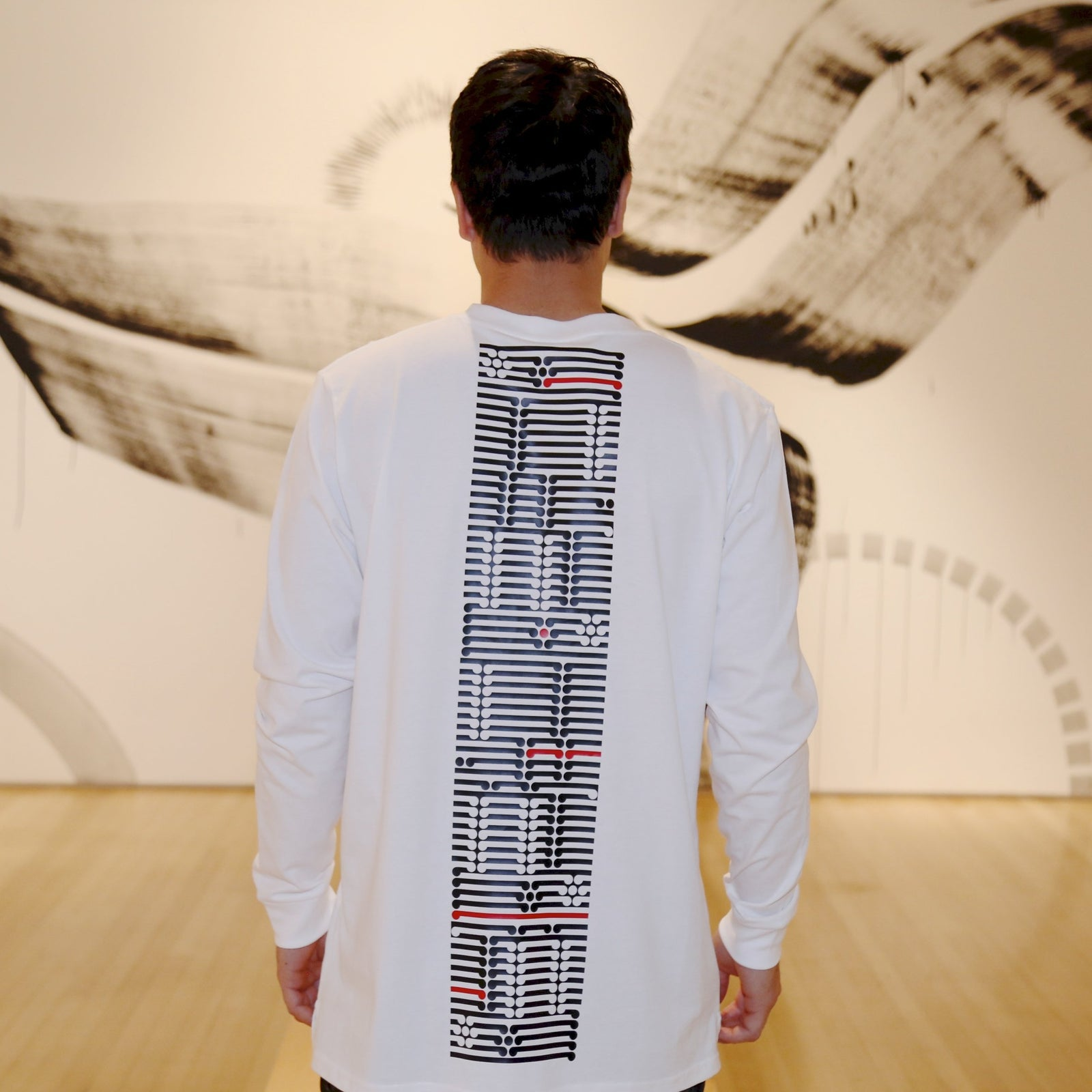 Mens white long sleeve tshirt with black and red ta moko designed back